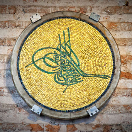 The tughra symbol is a monogram, seal or signiture of a sultan from the ottoman empire. This one is situated at the Hagia Sophia Mosque in Istanbul. photo