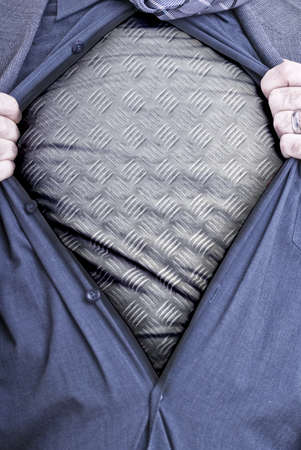 rips: A businessman rips open his shirt and shows how tough he is by revealing a metal plate beneath printed on a t-shirt