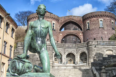 david and goliath: A statue of David the slayer of giants in the Swedish city of Helsingborg.