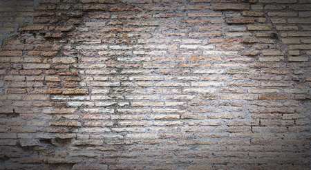 A grungy background texture of an ancient wall from the colosseum in Rome, Italy.