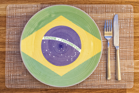 Dinner plate with the flag of Brazil on it for your international food and drink concepts. Stock Photo
