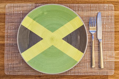 Assiette avec le drapeau de la Jamaïque pour vos concepts alimentaires et des boissons internationales.