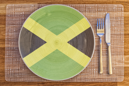 Dinner plate with the flag of Jamaica on it for your international food and drink concepts.