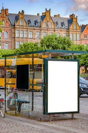 An image of a bus stop with a blank bilboard for your advertising situated in the swedish city of Lund.
