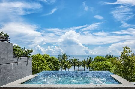 A private jacuzzi overlooks the ocean at a health spa resort in Hua Hin, Thailand.