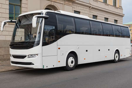 A white tourist couch bus with plenty of copy space for your own business logo. Standard-Bild