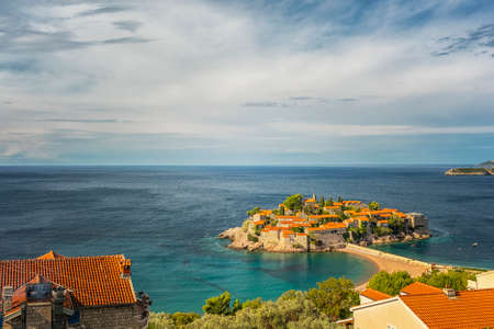 Sveti Stefan is a small islet and 5-star hotel resort on the Adriatic coast of Montenegro Not far from Budva. Stock Photo