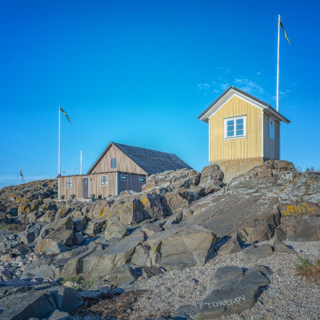 An image of the famous little yellow hut at Torekov on the Swedish coast.