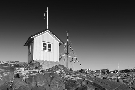 TOREKOV, SWEDEN - AUGUST 02, 2018: A black and white image of the famous little hut at Torekov on the Swedish coast.