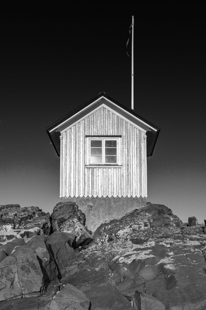 A black and white image of the famous little hut at Torekov on the Swedish coast.