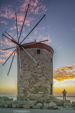A long exposure photograph of one of the windmills at Rhodes town on the historic Greek island
