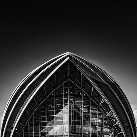 A fine art black and white edit of the armadillo auditorium in Glasgow near to the river clyde.