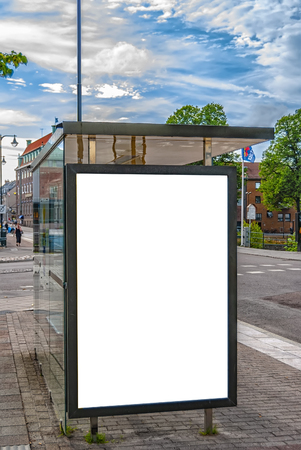 An image of a bus stop with a blank bilboard for your advertising situated in the swedish town of Halmstad.