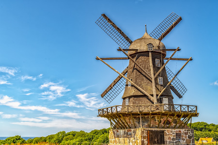 Bracke windmill in sweden sits on a hill overlooking the oresund straight between Sweden and Denmark.