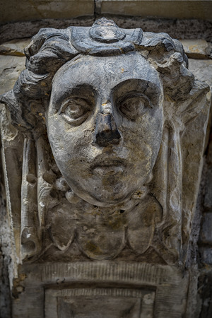 A carved head over a doorway in the danish town of Helsingor.