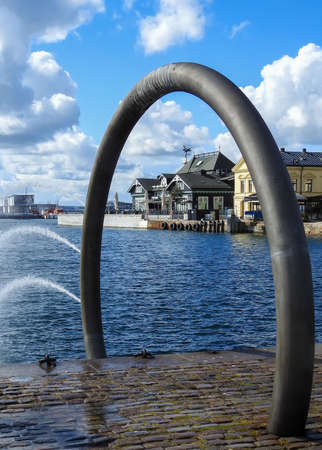 A view of the tivoli building in Helsingborg through the harbours ring fountain. Stock fotó