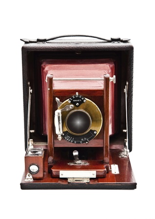 folding camera: Vintage plate camera with rosewood front lens holder and folding leather bellows. It was made by the Gundlach Optical Company, Rochester, NY.