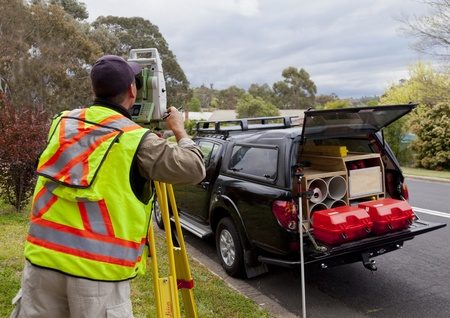 surveying: Surveyor checks measurements on new project Stock Photo
