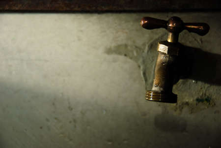 regulate: Water faucet inside a public school in the Philippines Stock Photo