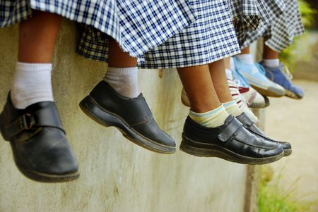 School children hanging out outside their roon Stock Photo
