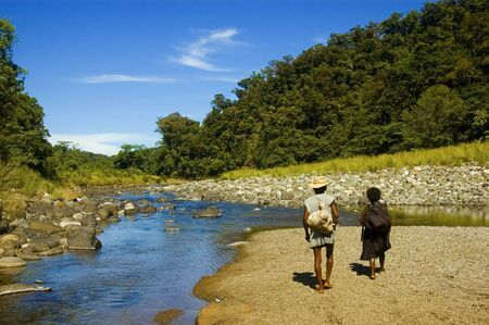 way of living: Dumagats, the indigenous people living in the Sierra Mountain Ranges in the Philippines on their way to the nearest town, which is an 11-hour walk Stock Photo