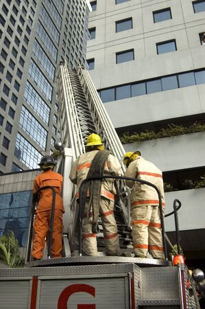 Firemen during fire drill in one of Metro Manilas cities Stock Photo