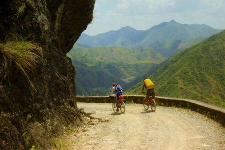 adventurers: Two Mountain Biker Adventurers in the Philippines Stock Photo
