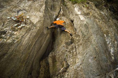 atop: Man rock climbing in one of El Nidos limestone walls