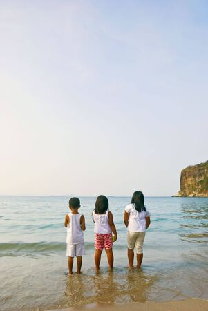 Asian children on beach photo