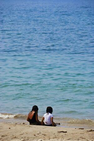 filipina: Asian teenagers sitting by the beach Stock Photo