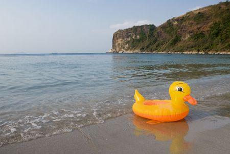 Yellow duck by the beach Stock Photo