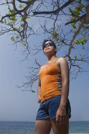 filipina: Asian woman standing on beach Stock Photo
