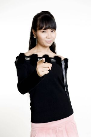 filipina: Asian woman points finger at camera, focus on fingers Stock Photo