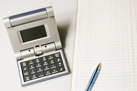 ledger: Calculator and alarm clock in one beside ledger Stock Photo