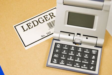 ledger: Calculator and alarm clock in one on top of ledger