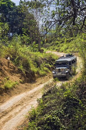 logging industry: The trustworthy Philippine jeepney on a remote area in the Philippines Stock Photo