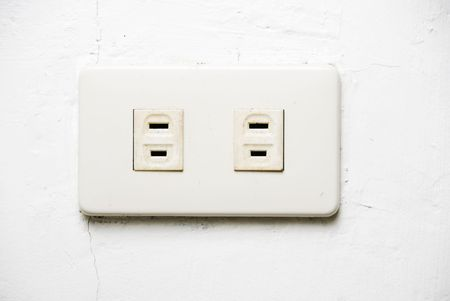 wall socket: White wall socket on uneven and dirty white wall