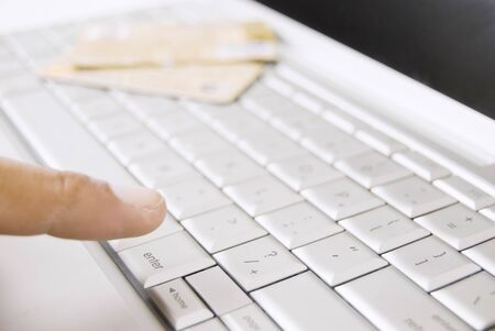 Finger of adult on computer keyboard and credit cards at background Stock Photo - 3332144