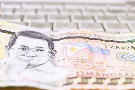 philippine: Philippine money on computer keyboard