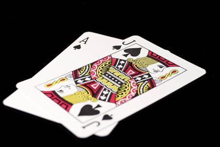 Blackjack cards against black background
