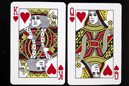 King and Queen of Hearts against black background Editorial