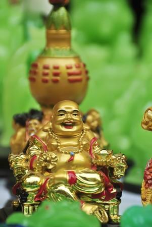 sidewalk sale: Golden Buddha for sale on sidewalk during Chinese New Year