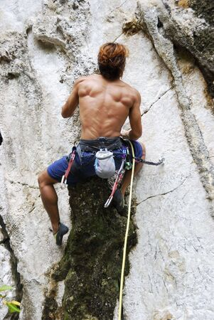 adventurous: Young man bouldering in Montalban, Philippines Stock Photo
