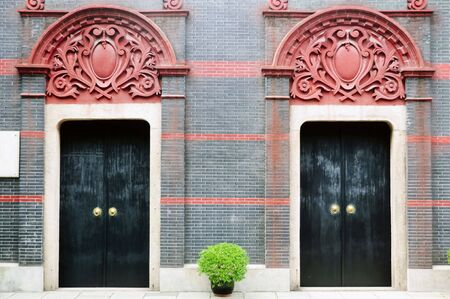 full shot: Full shot of two heavy wooden doors of an old residential structure in Shanghai, China