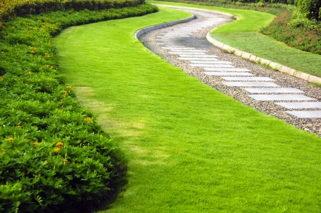 Winding walkway surrounded by well-manicured garden