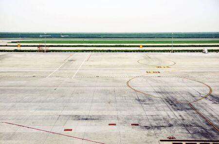 runways: Empty airfield of big airport; showing parking and three runways