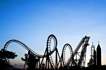 Silhouette of roller coaster; sunset Stock Photo