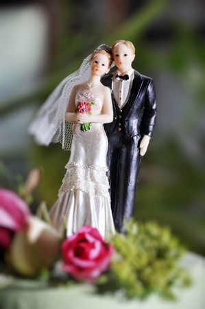 figurines: Bride and groom figurines on wedding cake