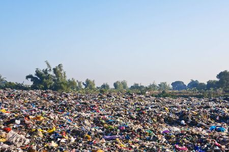 invade: A sea of garbage starts to invade and destroy a beautiful countryside scenery  Stock Photo