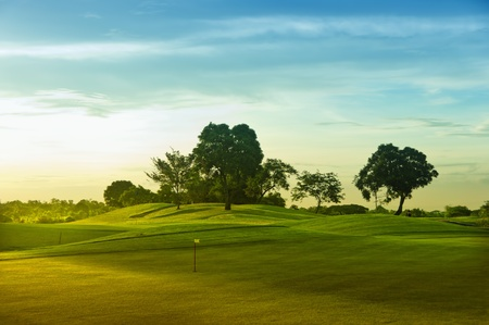 trees photography: A beautiful golf course in the Philippines during sunset Stock Photo
